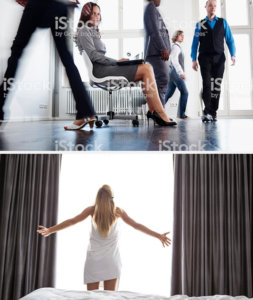 People in Office and Woman standing in front of window
