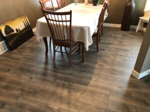 Dining Area with TORLYS Sugar Hill Laminate Flooring in Misty Hollow Oak