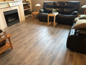 Living Room with TORLYS Sugar Hill Laminate Flooring in Misty Hollow Oak