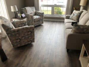 Family Room with TORLYS Sugar Hill Laminate Flooring in Misty Hollow Oak