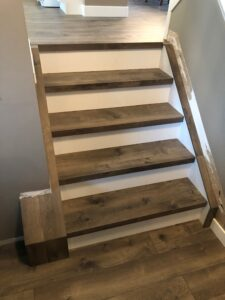 Staircase with TORLYS Sugar Hill Laminate Flooring in Misty Hollow Oak
